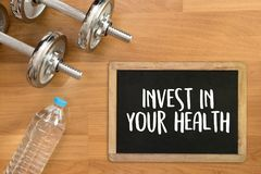 Investera i ditt vård- sunda livsstilbegrepp med bantar och fi Arkivbild