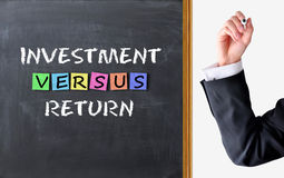 Investering tegenover terugkeerconcept Royalty-vrije Stock Foto
