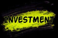 Investeringswoord met gloedpoeder royalty-vrije stock afbeeldingen