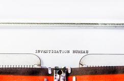 Investigation bureau text on typewriter Stock Photo
