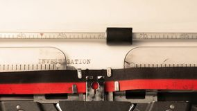 Investigation bureau text on typewriter, concept of investigation old style stock video