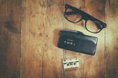 Investigation concept. tape recorder, cassete and glasses Royalty Free Stock Photo