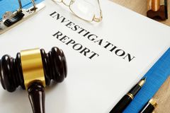 Investigation report on a table. Investigation report and gavel on a table royalty free stock images