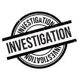 Investigation stamp rubber grunge Stock Photo