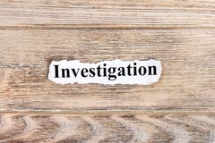 Investigation text on paper. Word Investigation on torn paper. Concept Image royalty free stock photography