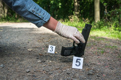 Investigator collects evidence - crime scene investigation royalty free stock photos
