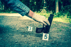 Investigator collects evidence - crime scene investigation stock image