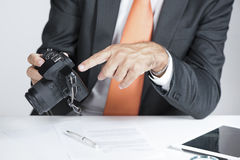 Investigator. Private investigator showing proof on a camera display stock images