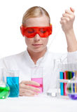 Investigator tests purple liquid in beaker Stock Photos