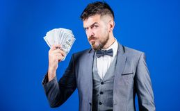 Investing money. Rich businessman with us dollars banknotes. Currency broker with bundle of money. Making money with his. Own business. Business startup loan stock image