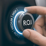 Investing and Profitability, High Return on Investment. Hand turning knob to select high return on investment, black and blue tones. ROI Concept. Composite image royalty free stock photos