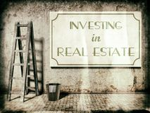 Investing in real estate on wall Royalty Free Stock Photo