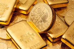 Investing in real gold. Than gold bullion and gold coins stock images