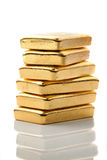 Investing in real gold. Than gold bullion and gold coins royalty free stock photography
