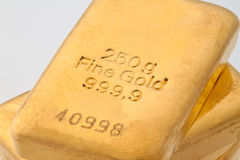 Investing in real gold. Ingot of gold royalty free stock images