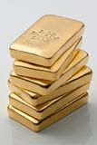 Investing in real gold than gold. Bullion and gold coins stock photos