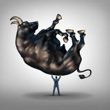 Investing Solutions. And financial leadership symbol and business success concept as a take charge businessman lifting a giant bull as an icon of a leader with Stock Photos