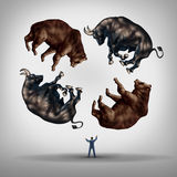 Investing In Stocks. Concept as a financial advisor or stock broker businessman juggling a group of bears and bulls as a symbol and metaphor for the challenge Royalty Free Stock Image