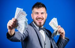 Investing to become rich. Business startup loan. Bearded man holding cash money. Making money with his own business. Currency broker with bundle of money. Rich stock photos