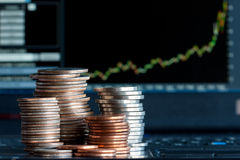 Investment. Stacks of coins  and a up trend chart as the background Royalty Free Stock Images