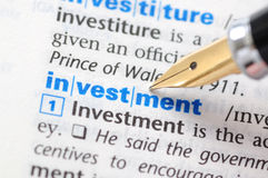 Investment. Fountain pen pointing investment word Stock Photos
