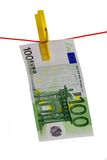 Investment. 100  Euro Bill on a Clothes Line on White Background Stock Photos