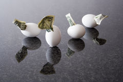 Investment. Hatching dollar bills from eggs on granite desk Royalty Free Stock Images