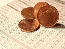 Investment. Four pence on financial chart Stock Images