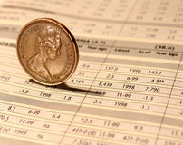 Investment. One penny on financial report Royalty Free Stock Image