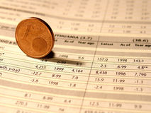 Investment. One euro cent on financial report Royalty Free Stock Photo