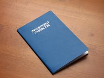 Investment account passbook. An investment account passbook on a wooden desk top royalty free stock photos