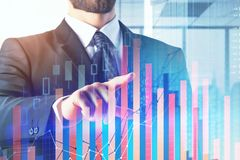 Investment and analysis concept. Businessman with abstract forex chart on glowing city background. Double exposure Royalty Free Stock Images