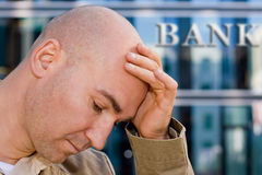 Investment banker in despair. Sad man holding his head in despair Royalty Free Stock Photos
