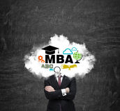 An investment banker is pondering over the master's degree in business administration. Stock Images