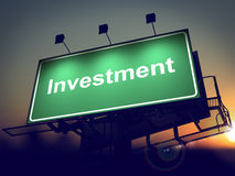 Investment - Billboard on the Sunrise Background. Royalty Free Stock Photography