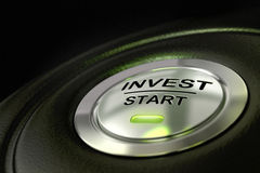 Investment concept. Abstract invest start button, metal material, green color and black textured background. Focus on the main word and blur effect. Investment Royalty Free Stock Photography