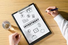Investment concept on a desk. Investment concept on a clipboard royalty free stock photos