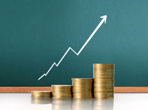 Coins graph stock market Stock Photography
