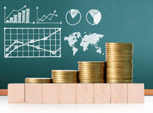 Coins graph stock market Royalty Free Stock Images
