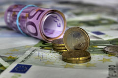 Investment concept. Euro coins and notes (EUR Royalty Free Stock Photos