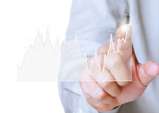 Investment concept with financial chart symbols coming from hand. Investment concept with financial chart symbols coming from a hand Stock Photo