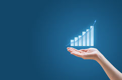 Investment concept. Hand and growth graph Stock Images