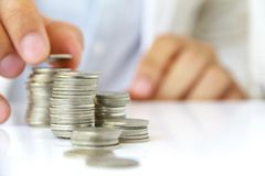 Investment concept. Hand holding coin stack, investment concept Stock Photography