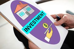Investment concept on a paper. Held by a hand stock photo
