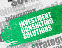 Investment Consulting Solutions on White Brick Wall. Business Education Concept: Investment Consulting Solutions on White Wall Background with Word Cloud Around Stock Photo