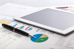 Investment. Data tablet list funds chart sale Royalty Free Stock Images