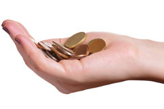 Investment and economy growth concept. Hand holding a pile of coins isolated in a white background Stock Photos