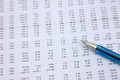 Investment figures with pen Stock Photo