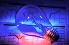 Investment Ideas. Photo of a Light Bulb abd Stock Chart With Colored Gel Lighting Stock Photography