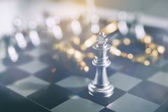 Business ideas and competition and strategy plan success. Investment Leadership Concept : The king chess piece with chess others nearby go down from floating royalty free stock photography